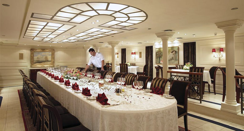 inside the Christina O super yacht showing the grand dining room
