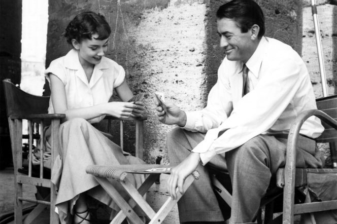Audrey Hepburn and Gregory Peck playing cards in Roman Holiday 1953
