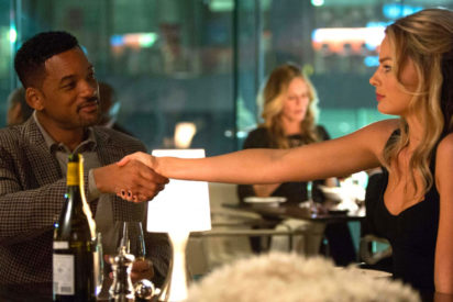 Margot Robbie shakes Will Smith's hand in Focus film