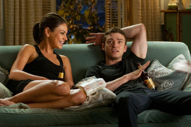 Mila Kunis and Justin Timberlake sitting on couch in Friends With Benefits