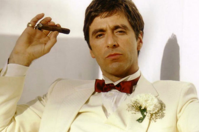 Al Pacino wearing white suit and holding cigar