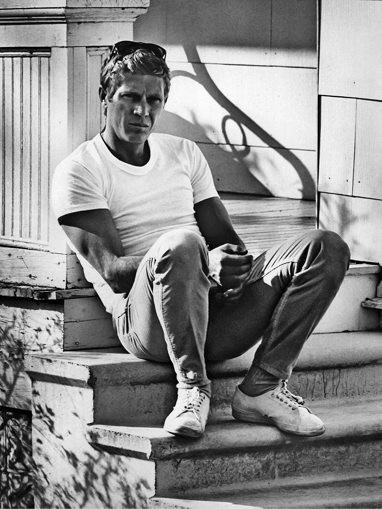 Steve McQueen wearing white t-shirt jeans and converse shoes