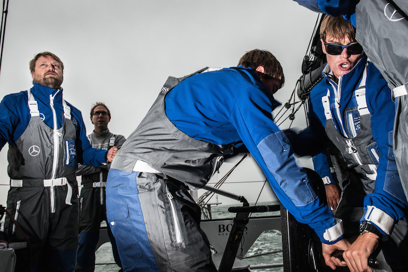 Image licensed to Lloyd Images - Free for editorial use The 2015 Artemis Challenge as part of Aberdeen Asset Management Cowes Week 2015. Cowes. Isle of Wight. Pictures of skipper Alex Thomson (left) and Oliver Cheshire (far right) on board HUGO BOSS - IMOCA 60 at the start of the 2015 Artemis Challenge Credit: Lloyd Images