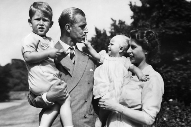 Prince Philip and Queen Elizabeth II with their children, Prince Charles and Princess Anne in July 1951 - Getty by Ullstein Bild
