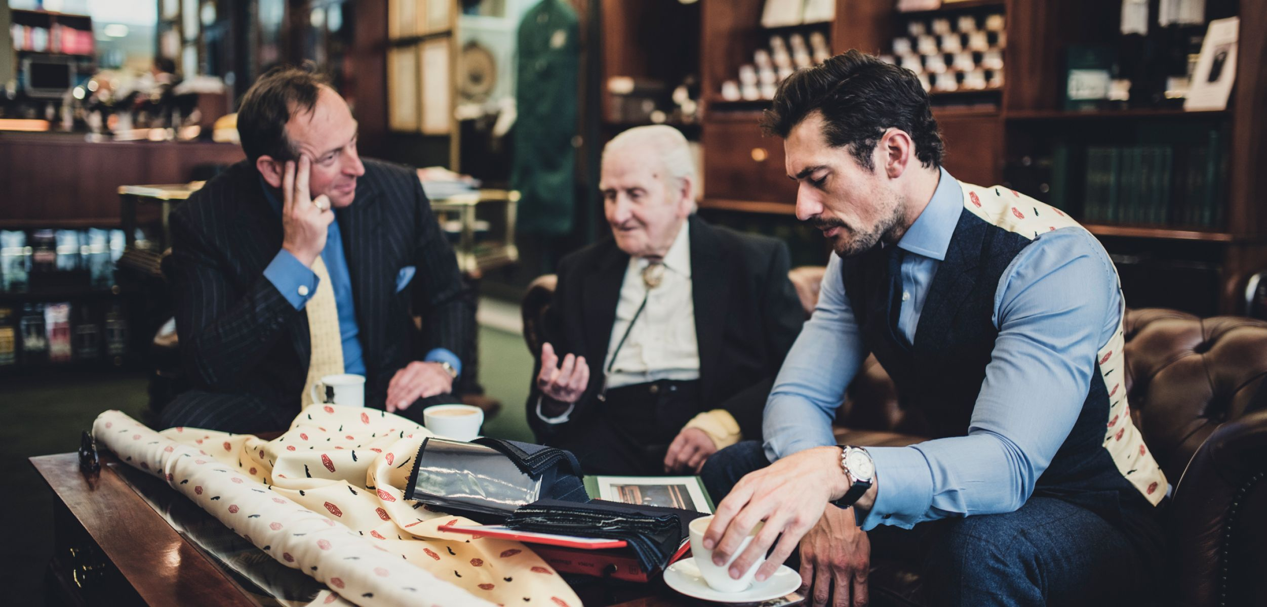 Inside Henry Poole Norman Dewis OBE, David Gandy and Simon Cundey gather to look at fabrics