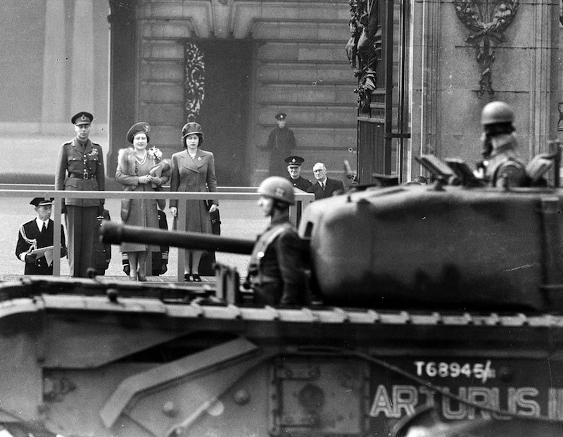 1944 - King George VII, the Queen Mother and Elizabeth watch a passing Churchill tank. (Popperfoto:Getty)