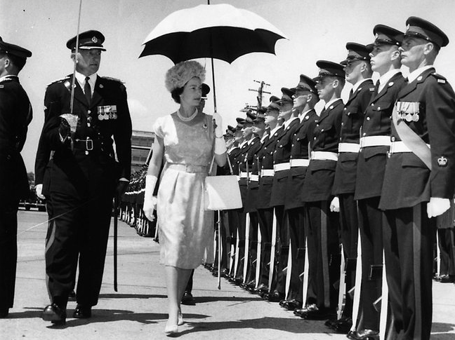 1963 - Queen Elizabeth inspects troops shortly after arriving ashore at Newstead Wharf, Brisbane, Australia (Getty Images)