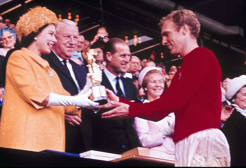 1966 - Queen Elizabeth presents England football captain Bobby Moore with the World Cup Trophy. (AP)