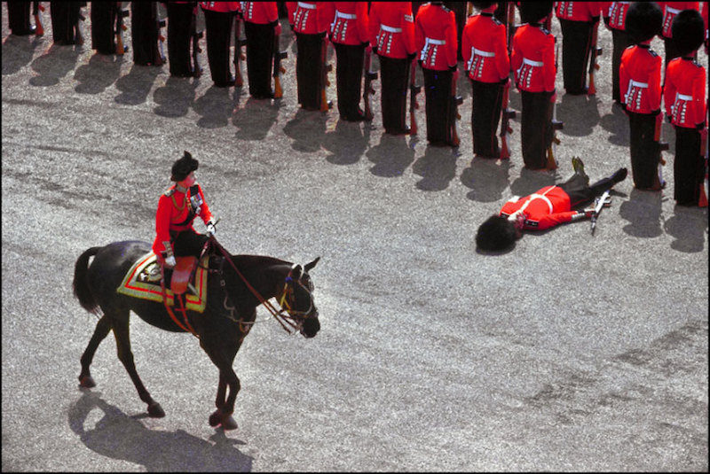 1970 - The Queen passes a fainted Guardsman while inspecting the troops. (Getty Images)