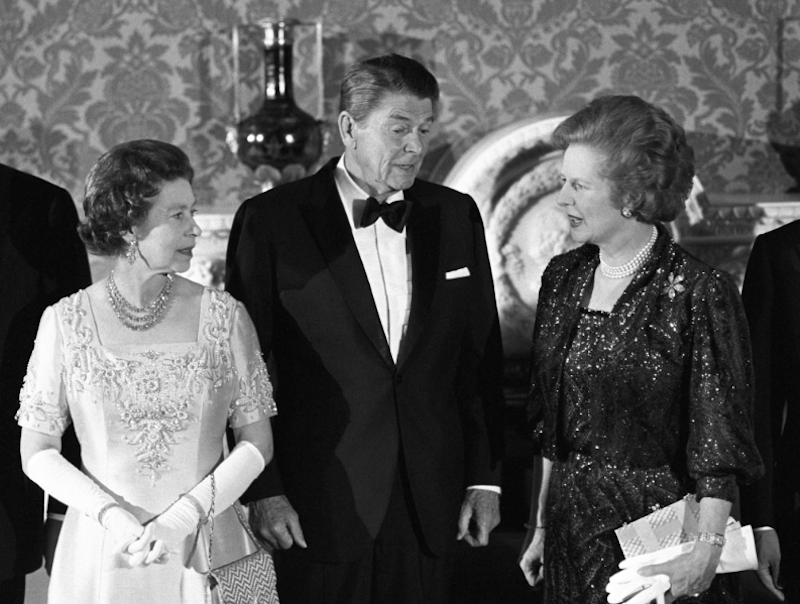 1984 - Elizabeth, Margaret Thatcher and Ronald Reagan at a banquet following the London Economic Summit. (Press Association)