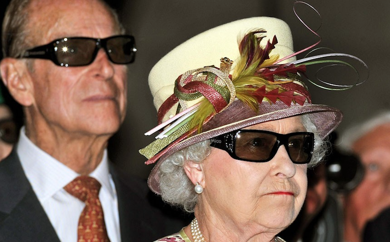 2010 - The Queen and the Duke of Edinburgh wear 3d glasses while at a film screening at Pinewood Studios in Toronto, Canada. (John Stillwell)