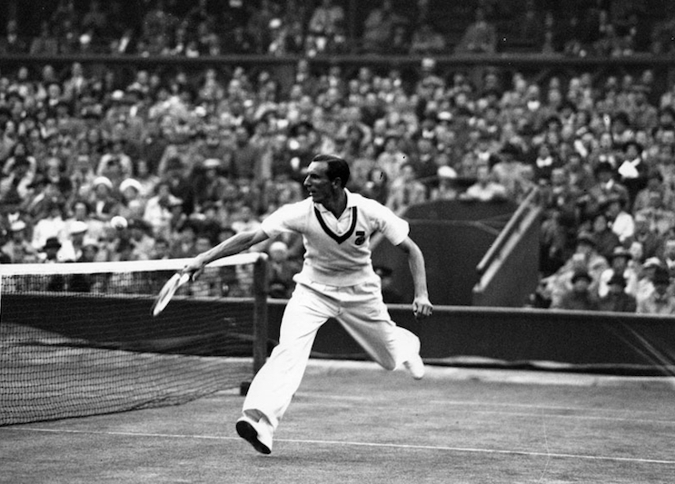 28th July 1936: Fred Perry of Great Britain in action against Jack Crawford of Australia during their Davis Cup match at Wimbledon. Britain beat Australia 3-2. (Photo by Topical Press Agency/Getty Images)