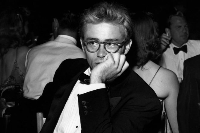 James Dean wearing glasses in a tux