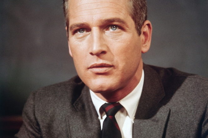 Paul Newman wears a suit and tie