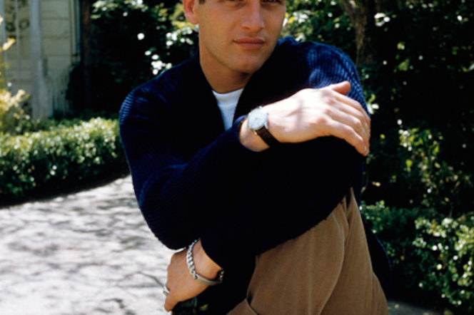 Paul Newman wears chino trousers, white trainers, watch and a bracelet