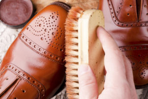 shoecare of leather brogues with brush