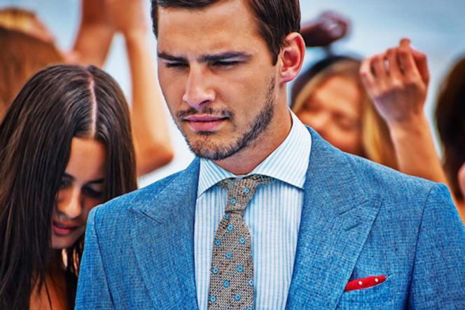 Suitsupply ad campaign with a model wearing a linen blue suit jacket