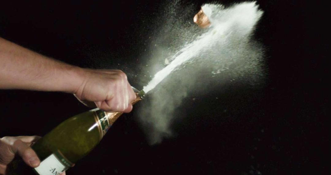 The coolest way to open a bottle of Champagne