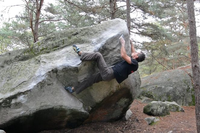 a man rock climbing in France