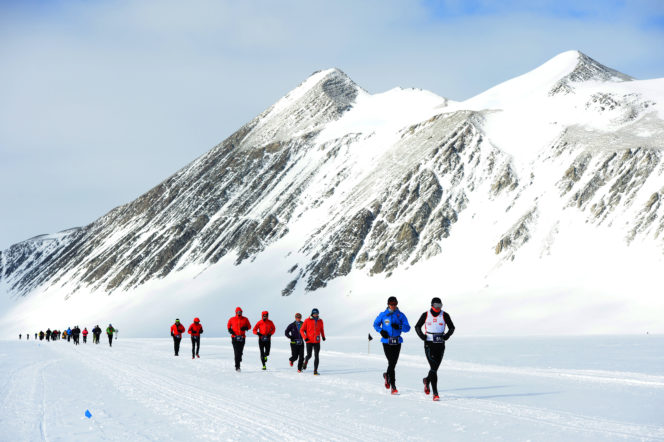 A group of runners complete an ice marathon across antarctica