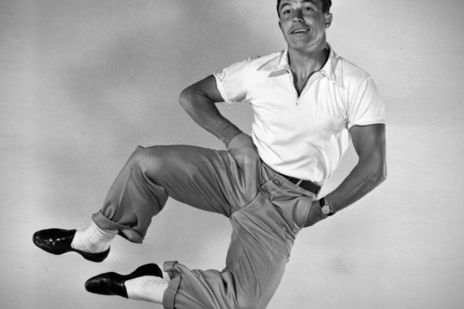 Gene Kelly jumps in iconic photograph wearing black loafers