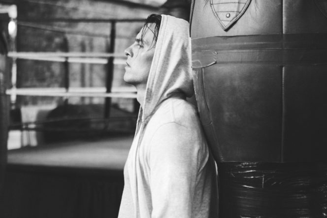Model wears hoodie in boxing gym, photographed by Adam Fussell for Gentleman's Journal