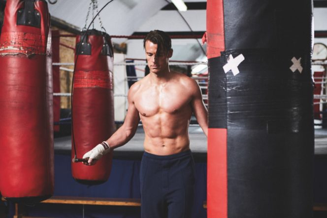 Model uses skipping rope in boxing gym, photographed by Adam Fussell for Gentleman's Journal