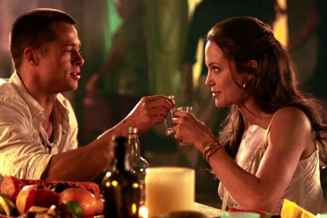 Angelina Jolie and Brad Pitt at a dinner scene