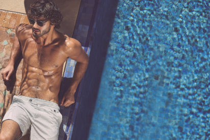 model wears swim shorts by the poolside, photographed by Adam Fussell for Gentleman's Journal