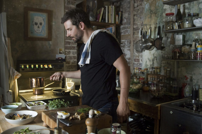 Bradley Cooper cooking in the kitchen