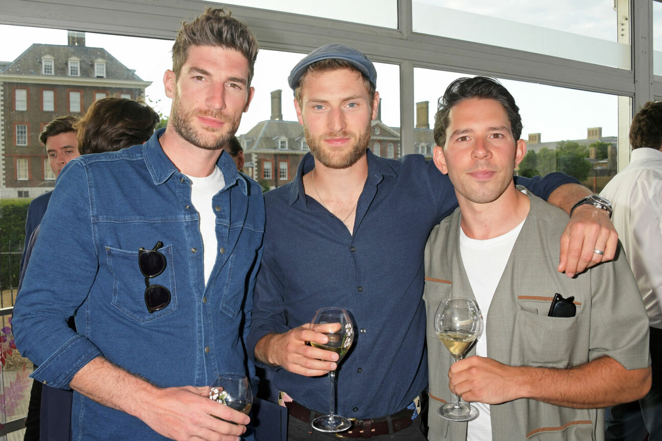 Ryan-Barrett-guest-and-Adam-Fussell-at-The-Gentlemans-Journal-Summer-Party-at-Masterpiece-London