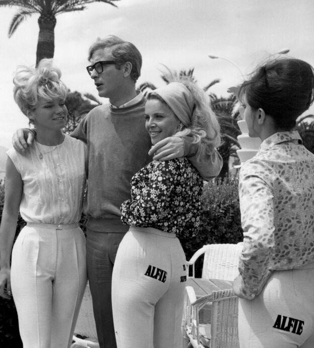 FRANCE - MAY 01: During Cannes film festival, the British actor Michael CAINE promoted his film ALFIE, in which he starred, by surrounding himself with young women wearing advertisements on their posteriors. (Photo by Keystone-France/Gamma-Keystone via Getty Images)