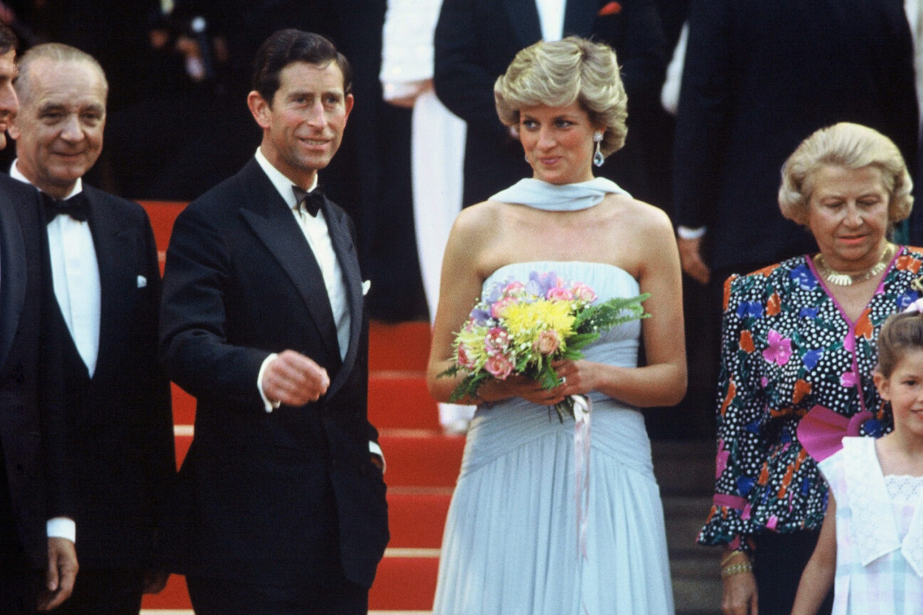 CANNES - MAY 15: Princess Diana, Princess of Wales, wearing a pale blue chiffon dress and matching stole by Catherine Walker, and Prince Charles, Prince of Wales attend Cannes film festival on May 15, 1987 in Cannes, France (Photo by Anwar Hussein/Getty Images)