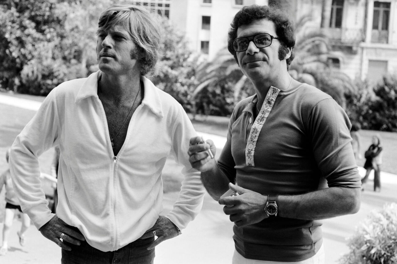 Photo taken in May 1972 shows (from L to R) US actor Robert Redford and director Sydney Pollack during the International Film Festival in Cannes. (Photo by - / AFP) (Photo credit should read -/AFP via Getty Images)